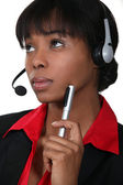 Afro-American woman wearing a headset — Stock Photo