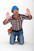 Tradesman surrounded by an invisible wall — Stock Photo