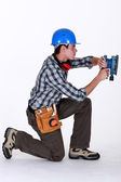 Tradesman using a sander — Stock Photo