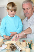 Grandfather spending quality time with his grandson — Stock Photo