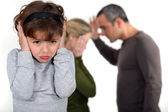 Couple having a quarrel in front of their little girl — Foto Stock