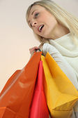Blond woman with shopping bags — Stock Photo
