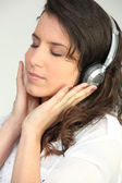 Portrait of a woman listening to music — Stock Photo