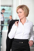 Woman with jacket over shoulder — Stock Photo