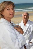 Couple wearing bathrobes — Stock Photo
