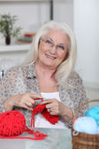 An old lady knitting. — Stock Photo