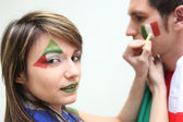 Italian football fans putting on facepaint — Stock Photo