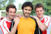 Portrait of 3 football players — Stock Photo