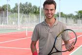 Male tennis player on a hardcourt — Stock Photo