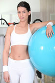 Young woman with fitness balloon — Stock Photo