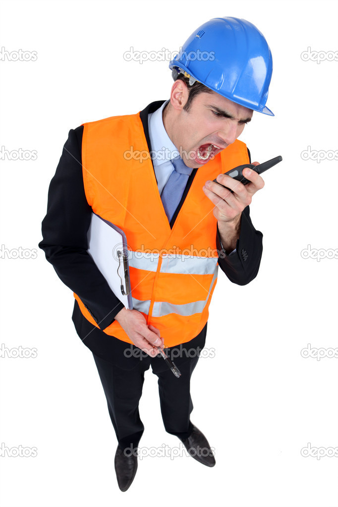 Engineer shouting into a two-way radio  Stock Photo #8171991