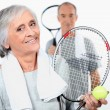 Elderly couple playing tennis — Stock Photo #8180172