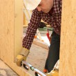 Woodworker using level spirit — Stock Photo #8180754