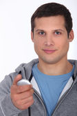 Young man with stopwatch — Stock Photo