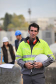 Foreman surveying construction — Stock Photo