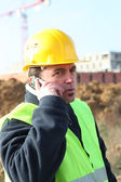 Foreman with a cellphone — Стоковое фото