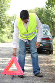 Man with security triangle — Stock Photo