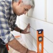 Man using spirit level — Stock Photo