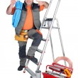 Handyman with a toolbox and cellphone — Stock Photo #8298253