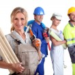 Workers with one in the foreground — Stock Photo #8298259