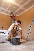 Two plasterers working on the same project — Stock Photo