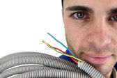 Electrician with conduit — Stock Photo