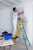 Man painting wall — Foto de Stock
