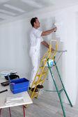 Stěna muž malba — Stock fotografie