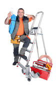 Handyman with a toolbox and cellphone — Stock Photo