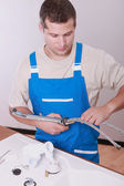 Plumber repairing a sink — Stock Photo