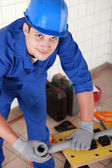 Plumber preparing pipe on work bench — Stock Photo