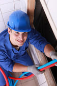 Young plumber working — Stock Photo