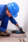 Worker drilling — Stock Photo