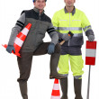 Two road workers posing together — Foto Stock