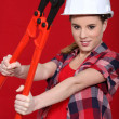 Stock Photo: Womholding bolt cutters