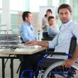 Working man in wheelchair — Stock Photo