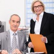 Manger with assistant in office — Foto Stock