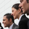 Line of smiling executives — Stock Photo