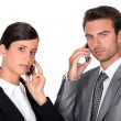 Executive couple using cellphones — Stock Photo #8320870