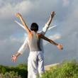 Couple stood mimicking wind farm — Stock Photo
