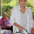 Daughter ironing — Stockfoto