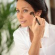 Woman with make-up brush — Stock Photo