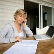 Stock Photo: Woman working at home