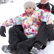 Couple on a sledge — Stock Photo