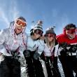 Group of teenagers skiing — Stock Photo