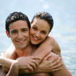 Couple hugging in the water — Stock Photo #8322790