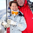 Older couple with skis — Stock Photo #8322792