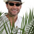 Tourist with straw hat — Stock Photo