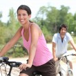 Couple cycling in the countryside — Stock Photo #8322876