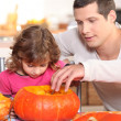 Stock Photo: Father and daughter preparing pumpkin